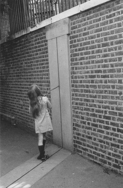 A girl with stick on the Greenwich Meridian Line in 1974